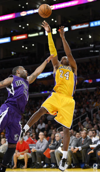 Los Angeles Lakers guard Kobe Bryant, right, puts up a shot as Sacramento Kings guard Marcus Thornton defends during the second half of their preseason NBA basketball game, Sunday, Oct. 21, 2012, in Los Angeles. The Kings won 99-92. (AP Photo/Mark J. Terrill)