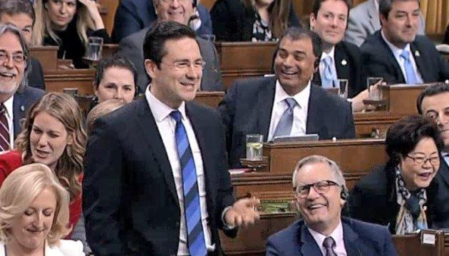 Conservative finance critic Pierre Poilievre cracks up in question period on March 21, 2018.