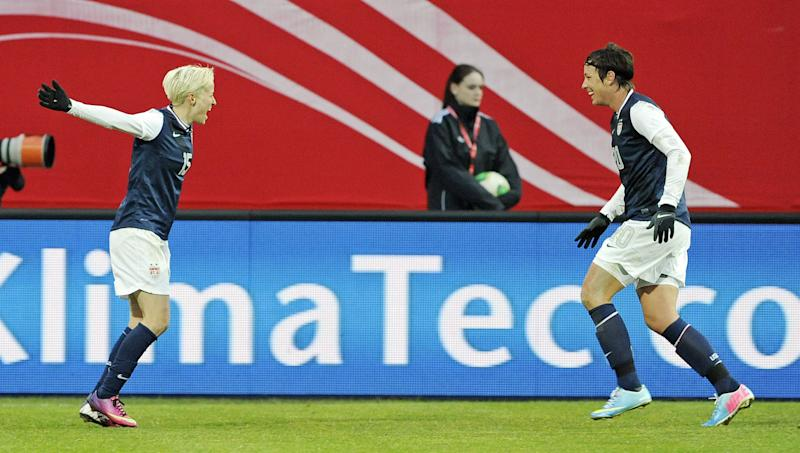 Megan Rapinoe, left, celebrates scoring with her teammate Abby Wambach, right, both of the U.S., during the international friendly women's soccer match between Germany and the United States in Offenbach, central Germany, on Friday, April 5, 2013. (AP Photo/Jens Meyer)