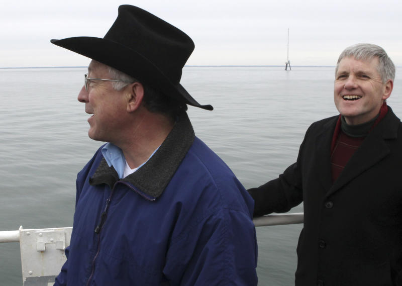 FILE - In this Feb. 2, 2010 file photo, Secretary of the Interior, Ken Salazar, left. and Deputy Secretary of the Interior David Hayes, take in the view aboard the U.S. Coast Guard's Ida Lewis buoy tender while on an information gathering tour of Nantucket Sound regarding the viability of the Cape Wind power project.  Behind them is a 190-foot meteorological tower, part of the potential Cape Wind site. Federal Aviation Administration officials felt political pressure to approve the planned wind farm, and did so amid internal disagreements over how to ensure the wind turbines wouldn't interfere with local radar and compromise airplane safety, according to FAA documents obtained by the project's opponents.   (AP Photo/Julia Cumes, File)
