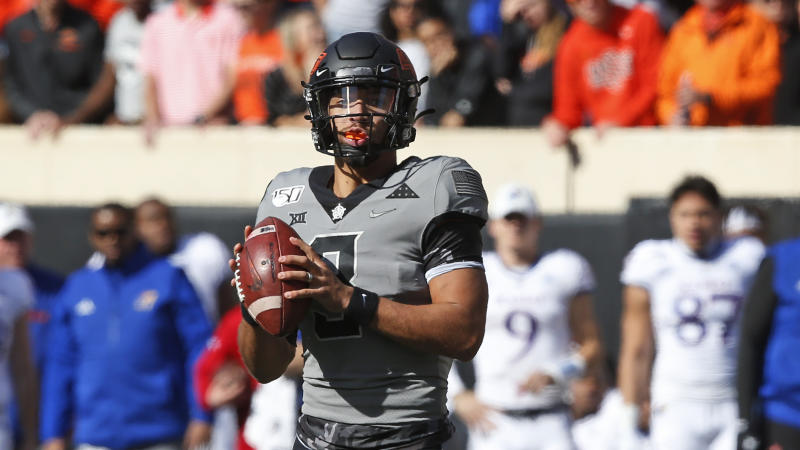 Oklahoma State quarterback Spencer Sanders (3) during an NCAA college football game against Kansas in Stillwater, Okla., Saturday, Nov. 16, 2019. (AP Photo/Sue Ogrocki)
