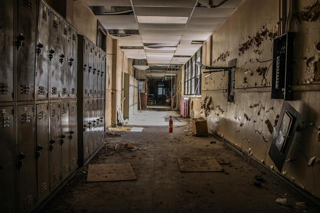 <p>Abandoned corridor with lockers. Some look vandalized, others look like they've been abandoned for only a few days rather than 10 years. (Photo: Leland Kent/Caters News) </p>