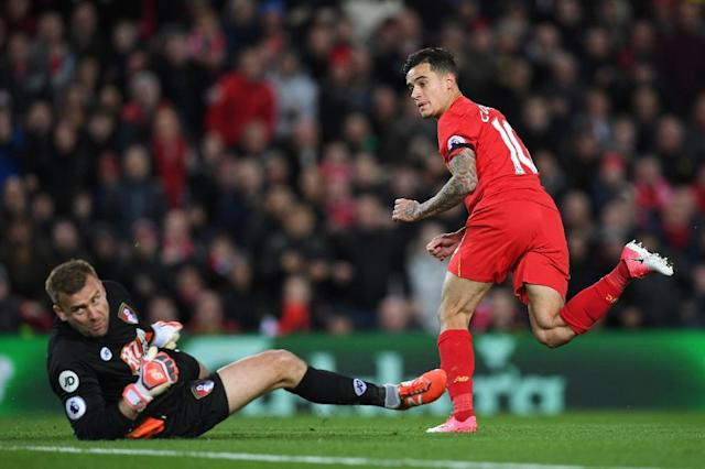 Liverpool's midfielder Philippe Coutinho (R) watches hsi shot beat Bournemouth's Polish goalkeeper Artur Boruc during the English Premier League football match between Liverpool and Bournemouth at Anfield in Liverpool, on April 5, 2017 (AFP Photo/Paul ELLIS)