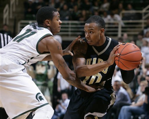 Arkansas-Pine Bluff's Lazabian Jackson, right, is pressured by Michigan State's Keith Appling during the first half of an NCAA college basketball game on Wednesday, Dec. 5, 2012, in East Lansing, Mich. (AP Photo/Al Goldis)