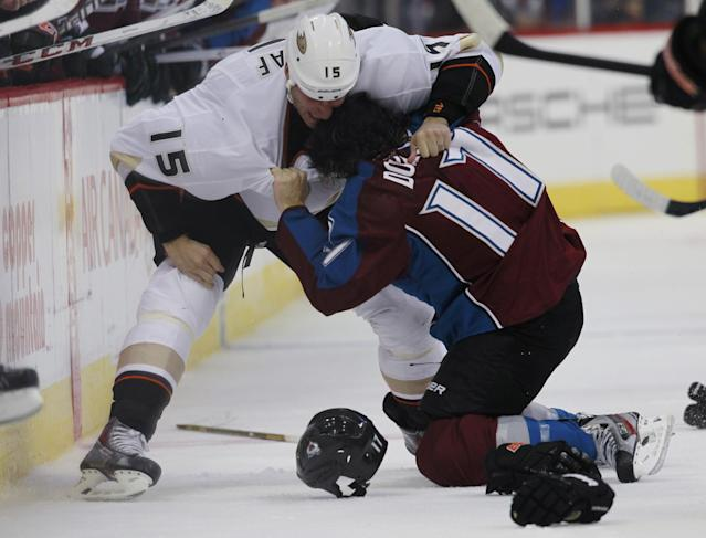 Anaheim Ducks center Ryan Getzlaf, left, fights with Colorado Avalanche right wing Steve Downie in the third period of the Avalanche's 6-1 victory in a hockey game in Denver on Wednesday, Oct. 2, 2013. (AP Photo/David Zalubowski)