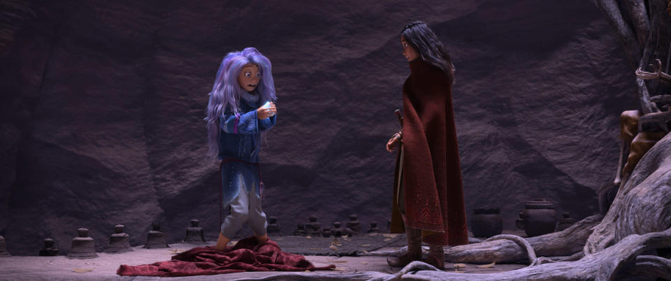 """Animated character Raya, voiced by Kelly Marie Tran, right, appears with Sisu, voiced by Awkwafina, in a scene from """"Raya and the Last Dragon."""" (Disney+ via AP)"""