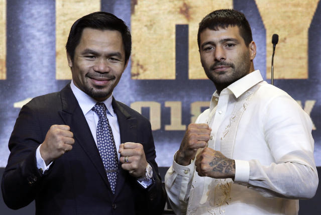 Philippine senator and boxing hero Manny Pacquiao, left, and Argentine WBA welterweight champion Lucas Matthysse pose for photographers during a press conference in Manila, Philippines on Wednesday, April 18, 2018. The two are scheduled to fight on July 15, in a World Boxing Association welterweight title fight in Malaysia. (AP Photo/Aaron Favila)