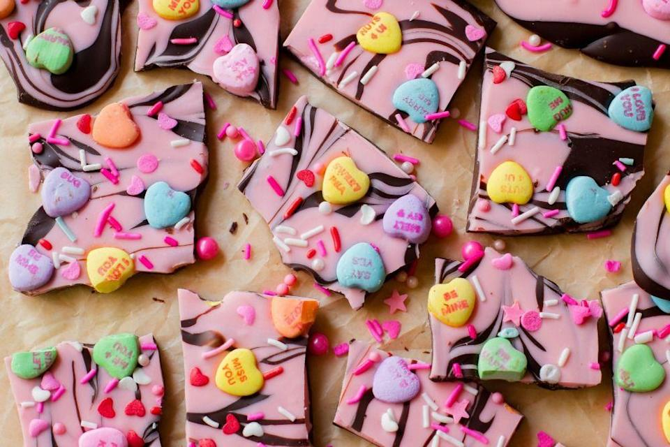 "<p>Conversation hearts are just better with chocolate.</p><p>Get the recipe from <a href=""https://www.delish.com/cooking/recipe-ideas/recipes/a45765/candy-heart-bark-recipe/"" rel=""nofollow noopener"" target=""_blank"" data-ylk=""slk:Delish"" class=""link rapid-noclick-resp"">Delish</a>.</p>"