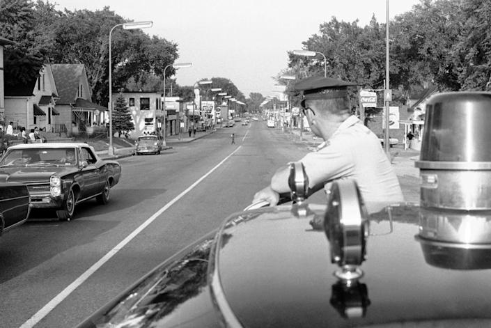 """<span class=""""caption"""">A Minneapolis police officer in a predominantly black area during unrest in 1967.</span> <span class=""""attribution""""><a class=""""link rapid-noclick-resp"""" href=""""http://www.apimages.com/metadata/Index/Watchf-AP-A-MN-USA-APHS390375-Race-Riot/441bc58b94da4601a1c0fcf9110885f0/11/0"""" rel=""""nofollow noopener"""" target=""""_blank"""" data-ylk=""""slk:AP Photo/Robert Walsh"""">AP Photo/Robert Walsh</a></span>"""