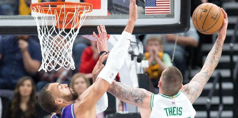Daniel Theis of the Boston Celtics shoots over Rudy Gobert of the Utah Jazz.