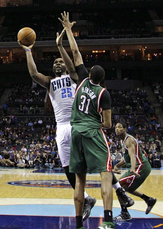 Charlotte Bobcats' Al Jefferson (25) shoots over Milwaukee Bucks' John Henson (31) during the second half of an NBA basketball game in Charlotte, N.C., Monday, Dec. 23, 2013. The Bobcats won 111-110 in overtime. (AP Photo/Chuck Burton)