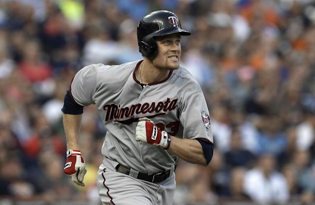 Minnesota Twins' Justin Morneau runs after hitting a double against the Detroit Tigers in the third inning of a baseball game in Detroit, Wednesday, Aug. 21, 2013. (AP Photo/Paul Sancya)