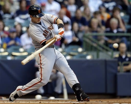 San Francisco Giants' Buster Posey hits a three-run home run during the first inning of a baseball game against the Milwaukee Brewers, Monday, May 21, 2012, in Milwaukee. (AP Photo/Morry Gash)