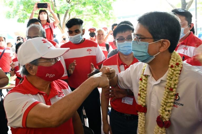 Fist bumps have replaced handshakes on the campaign trail as Singapore prepares for a general election, even as it recovers from a major coronavirus outbreak