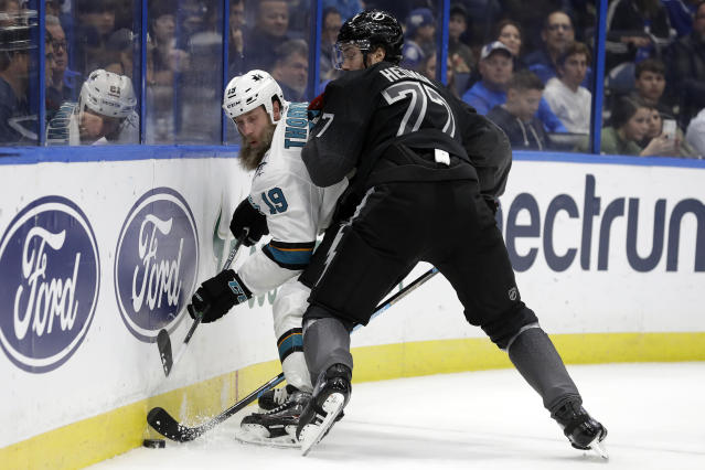 Tampa Bay Lightning defenseman Victor Hedman (77) pins San Jose Sharks center Joe Thornton (19) to the dasher during the first period of an NHL hockey game Saturday, Dec. 7, 2019, in Tampa, Fla. (AP Photo/Chris O'Meara)