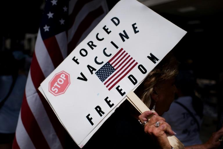 Anti-vaccine rally protesters hold signs outside of Houston Methodist Hospital in June 2021 - employees had sought to overturn a vaccine mandate, but their case was dismissed in a federal court (AFP/Mark Felix)