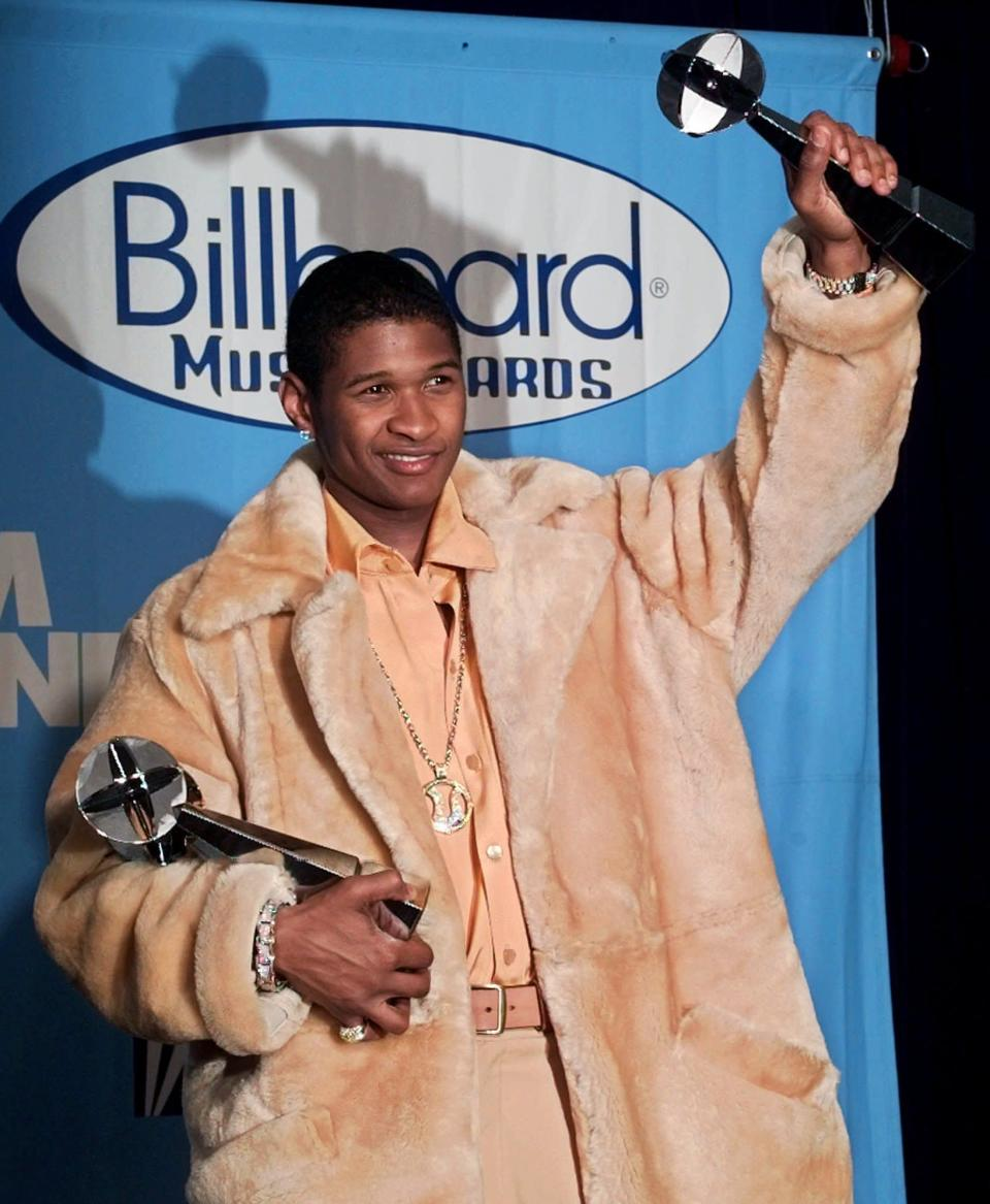 FILE - Usher poses backstage with his Artist of the Year award at the 1998 Billboard Music Awards in Las Vegas on Dec. 7, 1998. (AP Photo/Joey Terrill, File)