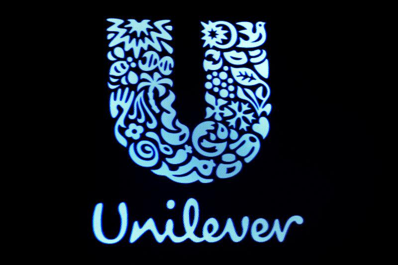 The company logo for Unilever is displayed on a screen on the floor of the NYSE