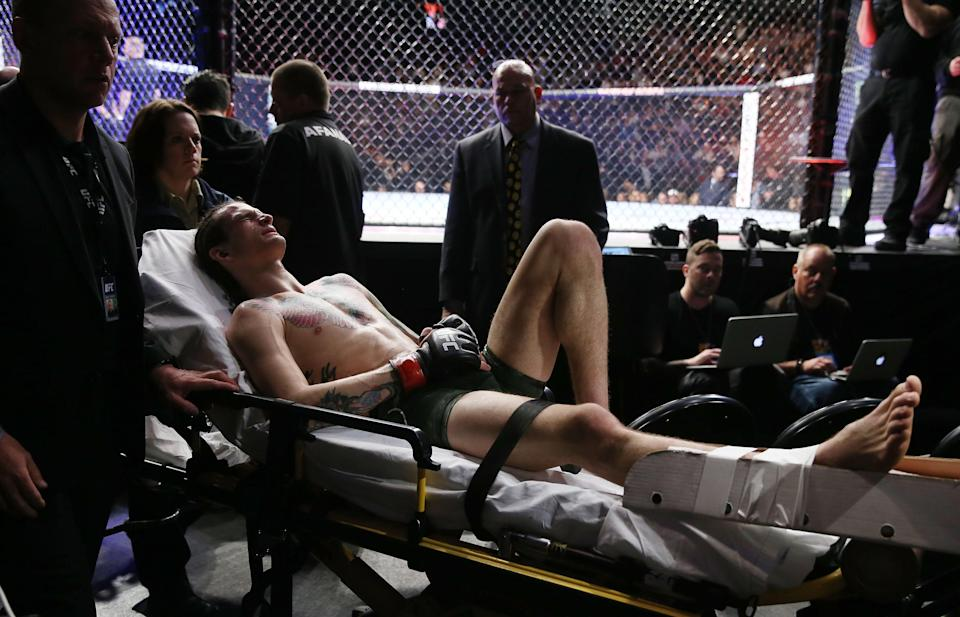 Sean O'Malley leaves the arena on a stretcher after injuring his lower right leg during a bantamweight bout against Andre Soukhamthath during UFC 222 at T-Mobile Arena on March 3, 2018 in Las Vegas, Nevada. (Getty Images)