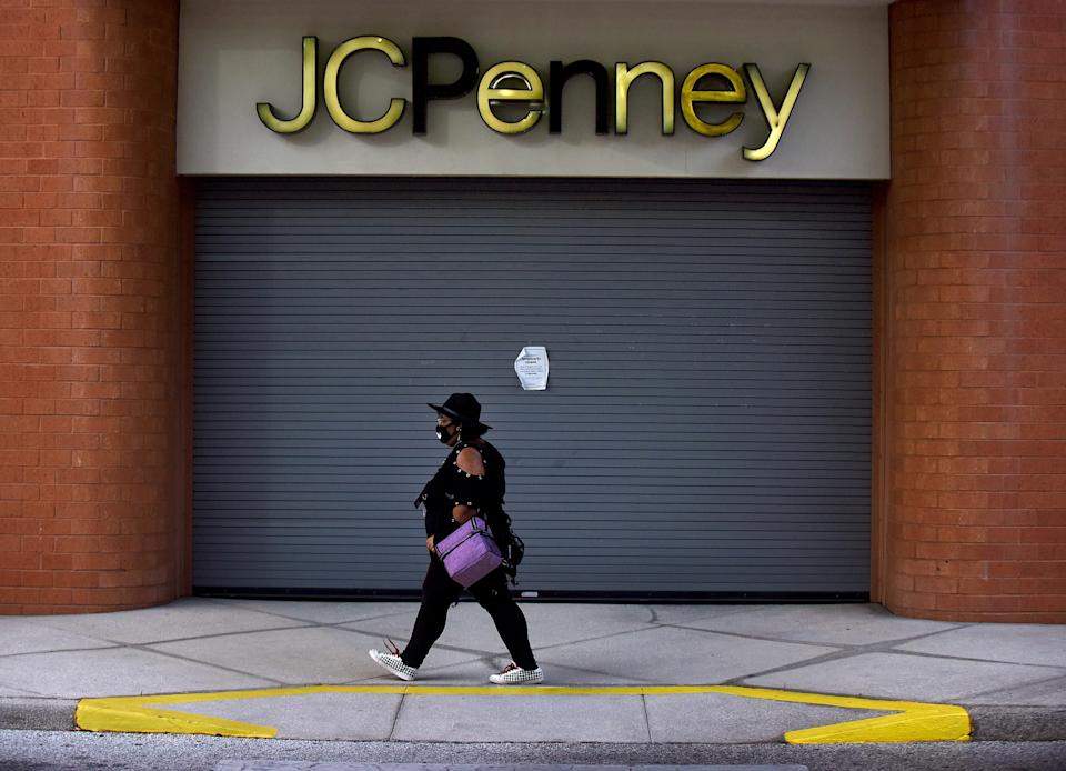 A woman walks by a JCPenney store that was temporarily closed on the day the company filed for bankruptcy protection and announced it would be closing some of its 800 stores amid the coronavirus crisis and ongoing debt problems. (Photo by Paul Hennessy/SOPA Images/LightRocket via Getty Images)