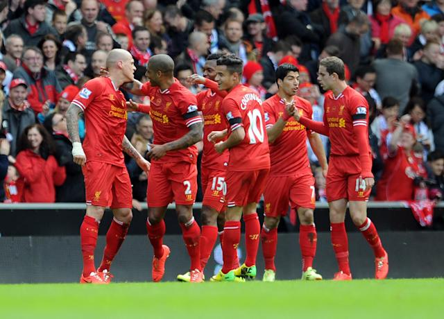 Liverpool's Martin Skrtel left, celebrates with his team-mates after he scores the second goal of the game for his side during their English Premier League soccer match against Manchester City at Anfield in Liverpool, England, Sunday April. 13, 2014. (AP Photo/Clint Hughes)