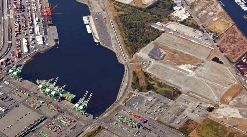 FILE - This Sept. 5, 2012, aerial photo provided by the Port of Tacoma shows the site of a proposed methanol plant at the Port of Tacoma, seen at right in Tacoma, Wash. A new federal lawsuit filed Tuesday, Nov. 12, 2019, aims to kill plans to build one of the world's biggest methanol refineries along the Columbia River. (Port of Tacoma via AP, File)