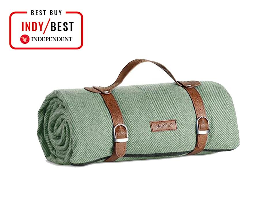 This picnic blanket from VonSheflooks smart and rolls up easily to be secured with dark brown leather-look carry straps (VonShef)