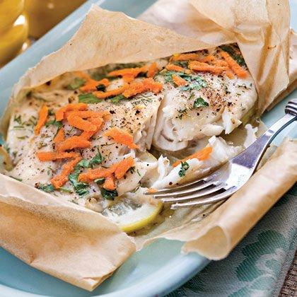 "<p><b>Recipe: <a href=""https://www.southernliving.com/syndication/lemon-dill-tilapia"">Lemon-Dill Tilapia</a> </b></p> <p>Tilapia gets a twist with lemon and dill, while shredded carrots and parsley give some great pops of color. Dig into this parchment paper packet immediately after popping it out of the oven for a perfectly warm, flaky fish fillet!</p>"