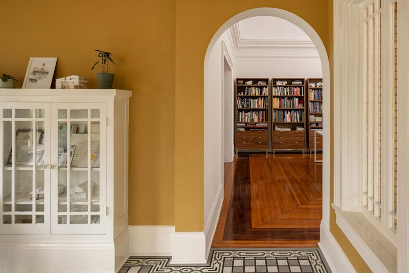 AFTER: While a neutral white covers most of the rooms, the brighter hues were added to specific rooms to amplify interior-view corridors.