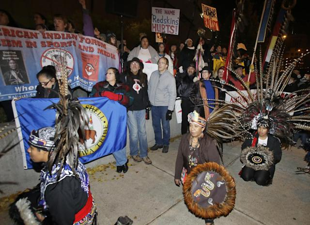 American Indians and their supporters gather outside the Metrodome to protest the Washington Redskins' name, prior to an NFL football game between the Redskins and the Minnesota Vikings, Thursday, Nov. 7, 2013, in Minneapolis. (AP Photo/Jim Mone)
