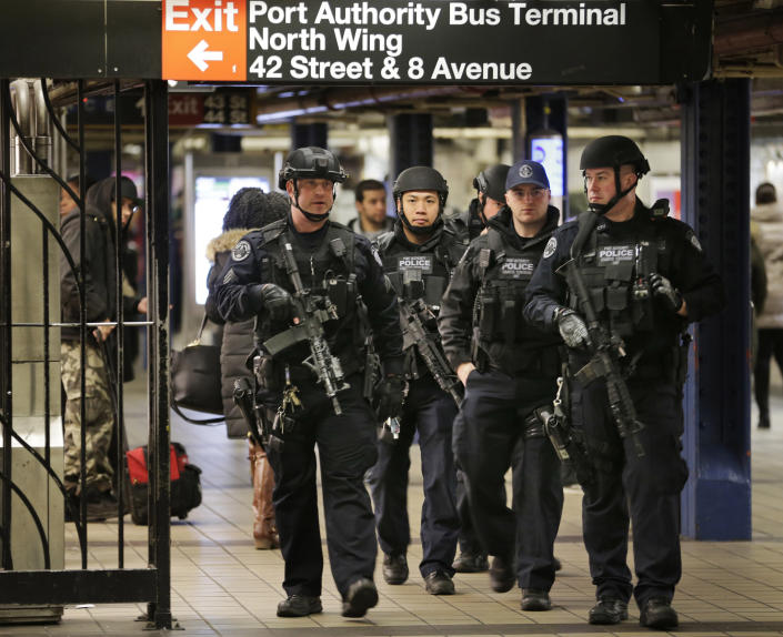 FILE — In this Dec. 12, 2017 file photo, police officers patrol in the passageway connecting New York City's Port Authority bus terminal and the Times Square subway station, near the site of an explosion the previous day. Akayed Ullah, a Bangladeshi immigrant whose subway pipe bomb mostly misfired, was sentenced Thursday, April 22, 2021, to life in prison for the 2017 attack in New York City busiest station. (AP Photo/Seth Wenig, File)
