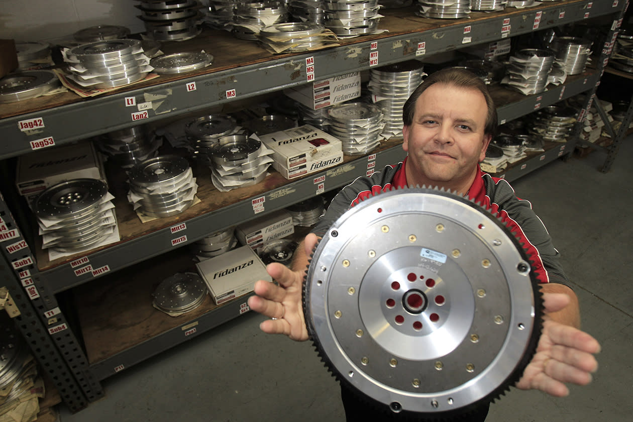 """Ed Burgy, vice president of sales and marketing for Fidanza, holds up a lightweight aluminum flywheel in Perry, Ohio. Burgy, a supporter of President Barack Obama, sees former Massachusetts Gov. Mitt Romney's plan to cut income tax rates across the board, including for the wealthiest households, as a return to trickle-down economics. """"I'm 46 and I've never seen it trickle down to me,"""" he says. """"The people who own the companies - they don't trickle it down to the employees. ... Show me the proof and I'll listen to you."""""""