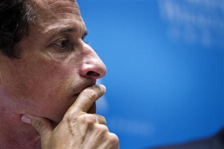 Weiner listens to fellow candidates speak at a debate held at the Museum of Tolerance in New York