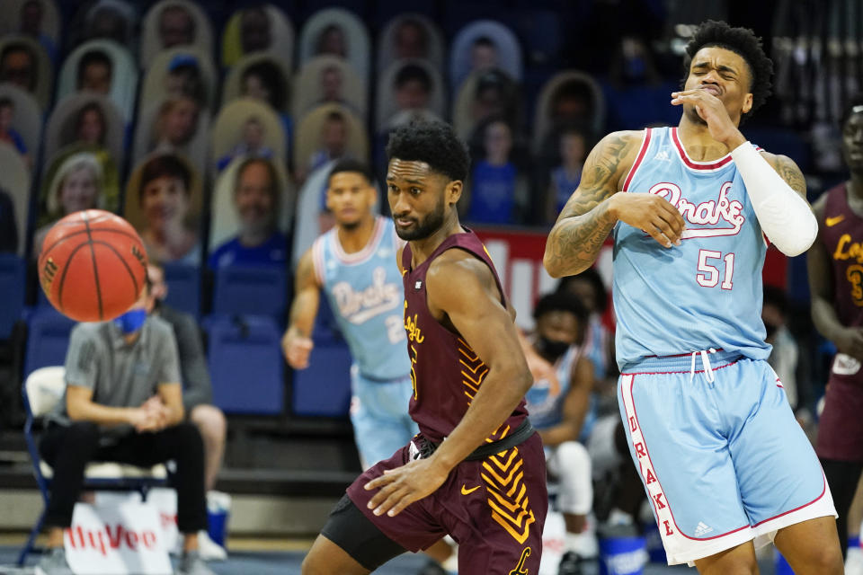Loyola of Chicago guard Keith Clemons, left, steals the ball from Drake forward Darnell Brodie (51) during the second half of an NCAA college basketball game, Saturday, Feb. 13, 2021, in Des Moines, Iowa. (AP Photo/Charlie Neibergall)