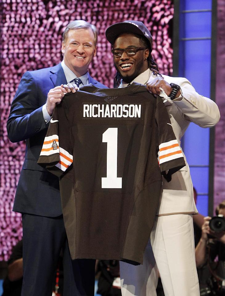 Alabama running back Trent Richardson, right, poses for photographs with NFL Commissioner Roger Goodell after being selected as the third pick overall by the Cleveland Browns in the first round of the NFL football draft at Radio City Music Hall, Thursday, April 26, 2012, in New York. (AP Photo/Jason DeCrow)