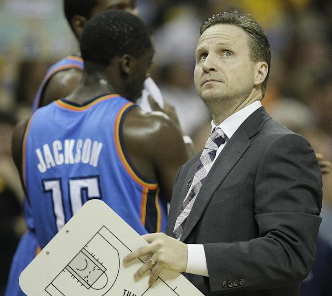 Oklahoma City Thunder coach Scott Brooks watches a replay during the first half of Game 4 in a Western Conference semifinal NBA basketball playoff series against the Memphis Grizzlies, in Memphis, Tenn., Monday, May 13, 2013. (AP Photo/Danny Johnston)