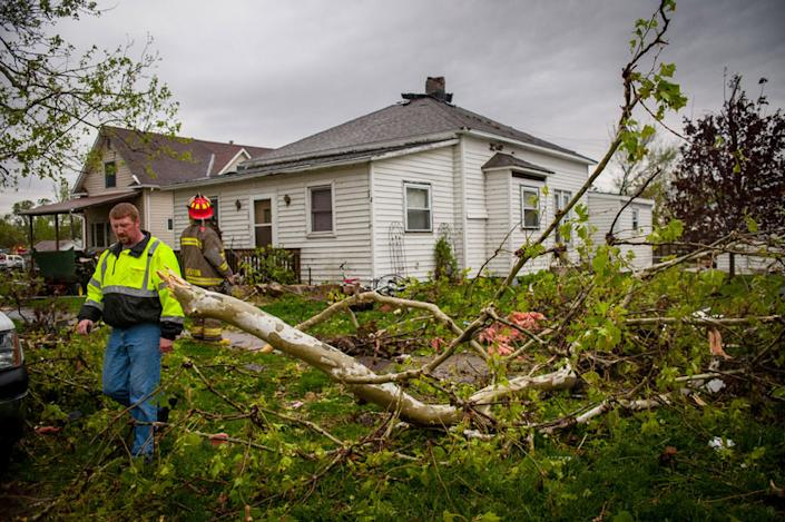 THURMAN, IA - APRIL 14: Members of local and area fire departments go house to house checking on residents after an apparent tornado April 14, 2012 in Thurman, Iowa. The storms were part of a massive system that affected areas from Northern Nebraska south through Oklahoma.