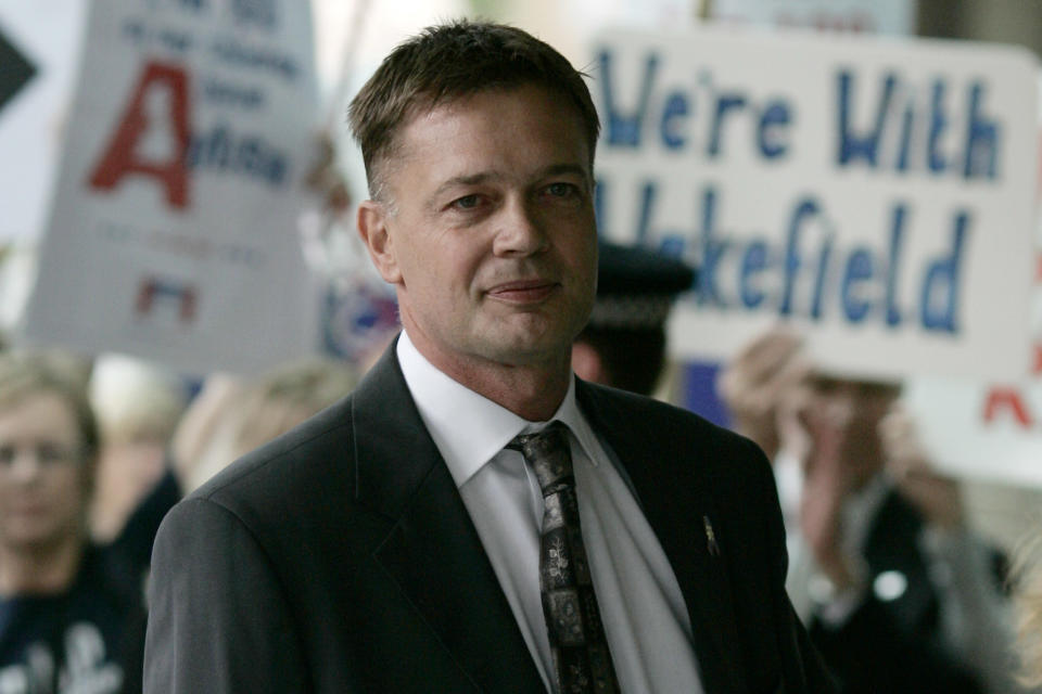 FILE - In this July 16, 2007 file photo Andrew Wakefield arrives at the General Medical Council in London to face a disciplinary panel investigating allegations of serious professional misconduct. Wakefiield'swork first linked vaccines and autism but it has since been discredited.Amid a measles outbreak in Minnesota, he has been meeting with local Somalis in Minneapolis. Some worry Wakefield is stoking vaccination fears, though organizers say the meetings are merely informational discussions. (AP Photo/Sang Tan, File)