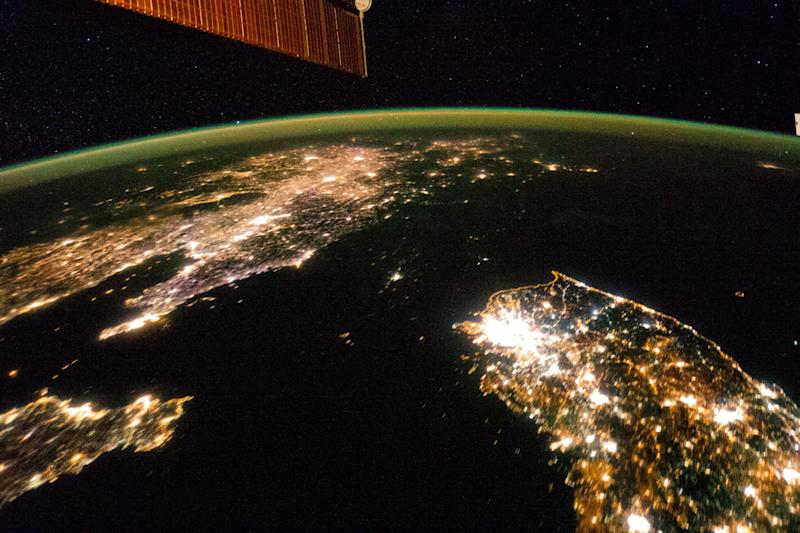 This Jan. 30, 2014 photo made available by NASA on Monday, Feb. 24, 2014 shows North Korea, darker area at center, between South Korea, right, and China, left. Lights from the North Korean capital, Pyongyang, are visible at center. The image comparing the night time lights of the countries was made by the Expedition 38 crew aboard the International Space Station. (AP Photo/NASA)