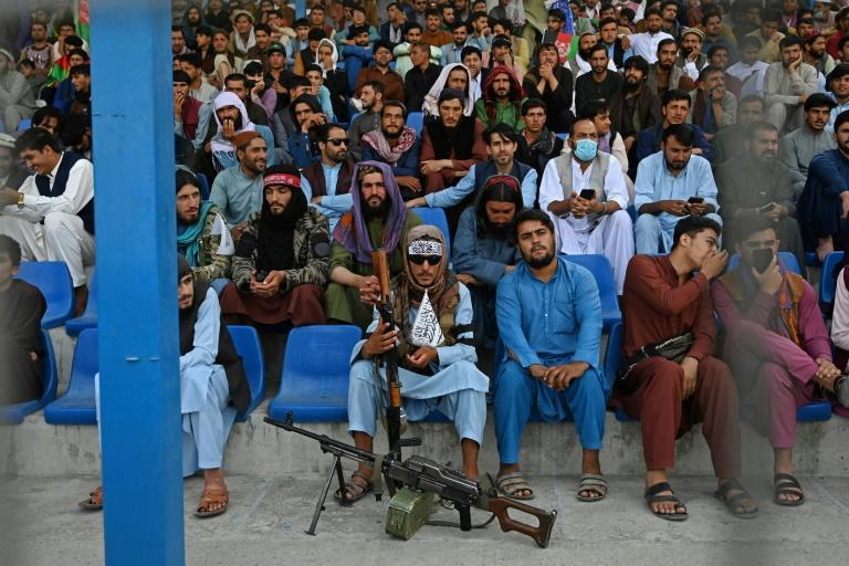 A contingent of Taliban fighters kept guard among the crowd at the stadium (AFP/Aamir QURESHI)