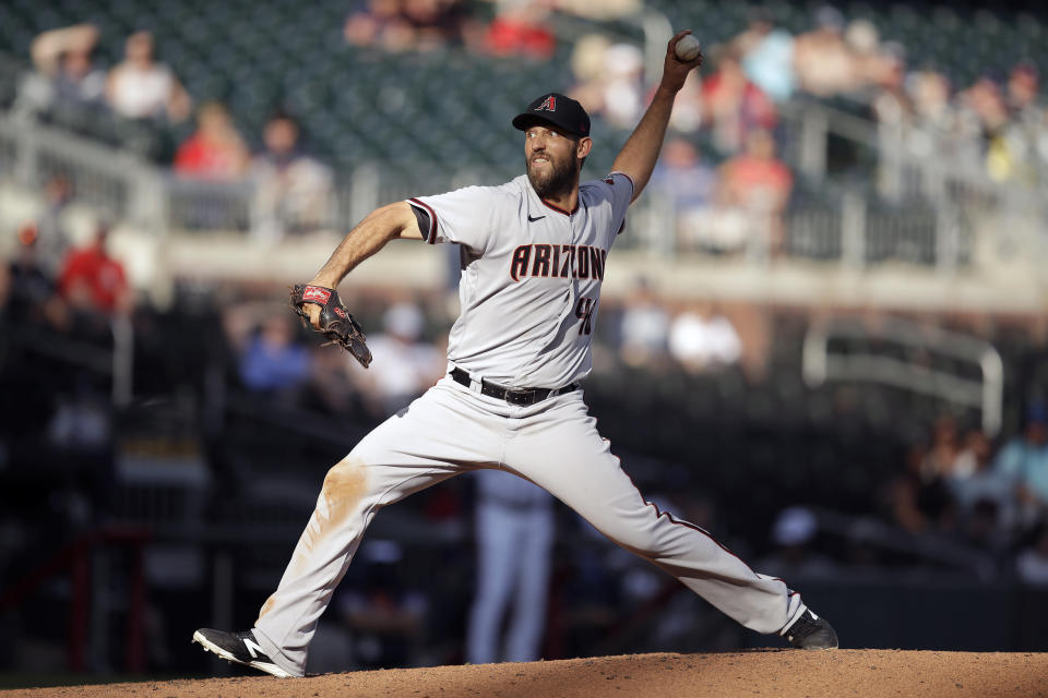 Arizona Diamondbacks pitcher Madison Bumgarner works against the Atlanta Braves in the seventh inning of the second baseball game of a double header Sunday, April 25, 2021, in Atlanta. (AP Photo/Ben Margot)