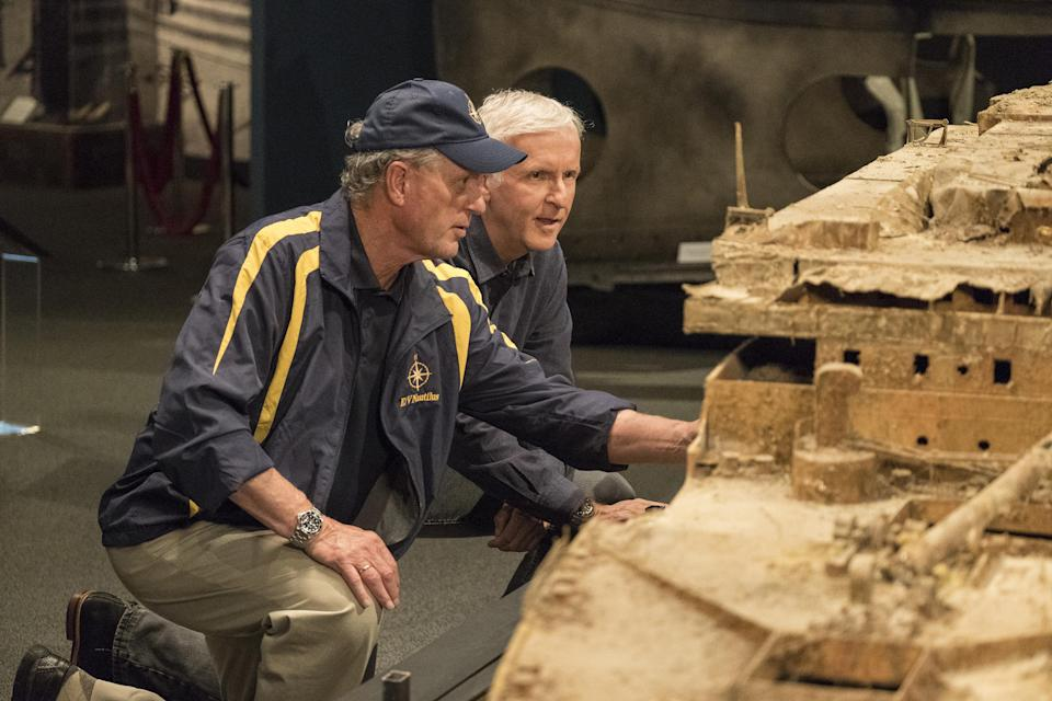 Oceanographer Bob Ballard and James Cameron study a scale model of the RMS Titanic in the documentary <em>Titanic: 20 Years Later With James Cameron</em>. (Photo: National Geographic/Mark Fellman)
