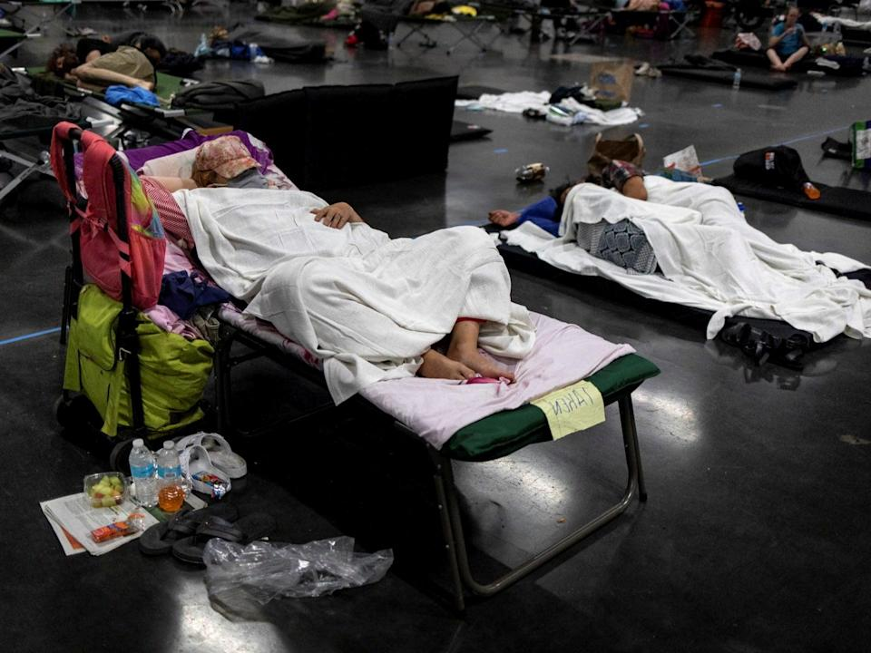 People sleep at a cooling shelter set up during an unprecedented heat wave in Portland, Oregon (REUTERS)