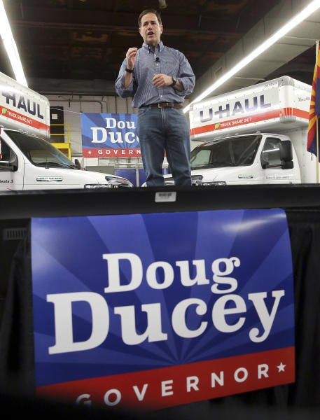 FILE - In this June 20, 2018 file photo, Arizona Gov. Doug Ducey, R, speaks at a campaign rally in Tempe, Ariz. The outrage sparked by the sights, sounds and stories of children separated from parents at the U.S.-Mexico border underscores the outsized role immigration will play in the midterms of this border state. Both Democrats and Republicans think the issue can propel them to victory in Arizona, a state with a large percentage of residents born abroad. (AP Photo/Matt York, File)