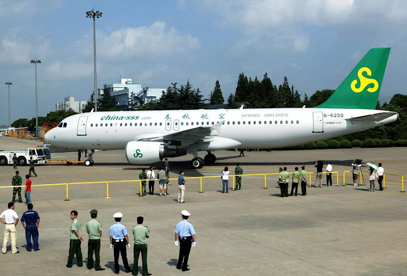 File photo taken in July 2005 shows a Spring Airlines jet at Shanghai's Hongqiao airport