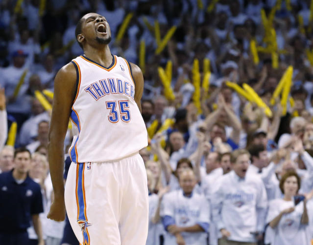 Oklahoma City Thunder forward Kevin Durant (35) reacts after a dunk late in the fourth quarter of Game 2 of an opening-round NBA basketball playoff series against the Memphis Grizzlies in Oklahoma City, Monday, April 21, 2014. Memphis won 111-105 in overtime. (AP Photo/Sue Ogrocki)