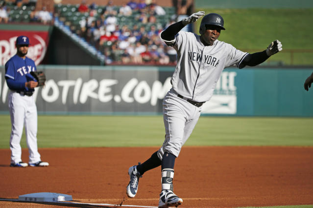New York Yankees shortstop Didi Gregorius (18) celebrates his two-run home run against the Texas Rangers as he rounds third base during the first inning of a baseball game Wednesday, May 23, 2018, in Arlington, Texas. (AP Photo/Michael Ainsworth)