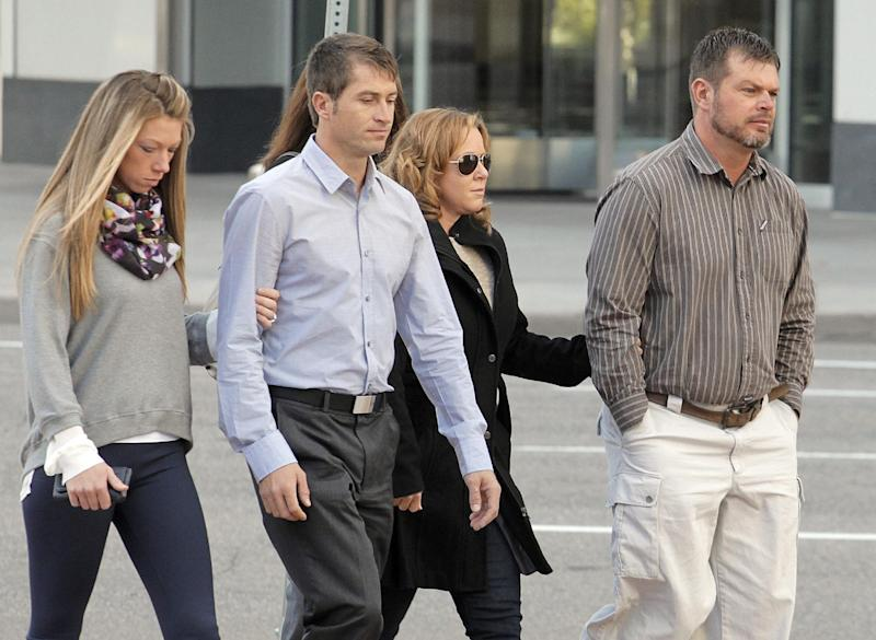 Eric Jensen, 37, right and Ryan Jensen, 33, brothers who owned and operated Jensen Farms, arrive at the federal courthouse in Denver, on Tuesday, Oct. 22, 2013, with family. The two Colorado farmers whose cantaloupes were tied to a 2011 listeria outbreak that killed 33 people pleaded guilty on Tuesday to misdemeanor charges under a deal with federal prosecutors.(AP Photo/Ed Andrieski)