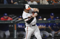 Baltimore Orioles' Austin Hays hits a single in the first inning against Texas Rangers starting pitcher Glenn Otto during a baseball game, Thursday, Sept. 23, 2021, in Baltimore. (AP Photo/Terrance Williams)