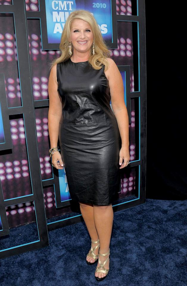 "Trisha Yearwood was all smiles upon hitting the arrivals line in a leather LBD and gold accents. Kevin Mazur/<a href=""http://www.wireimage.com"" target=""new"">WireImage.com</a> - June 9, 2010"